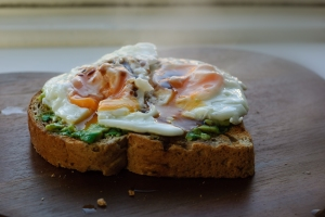 Toast with avocado, fried egg and soy sauce